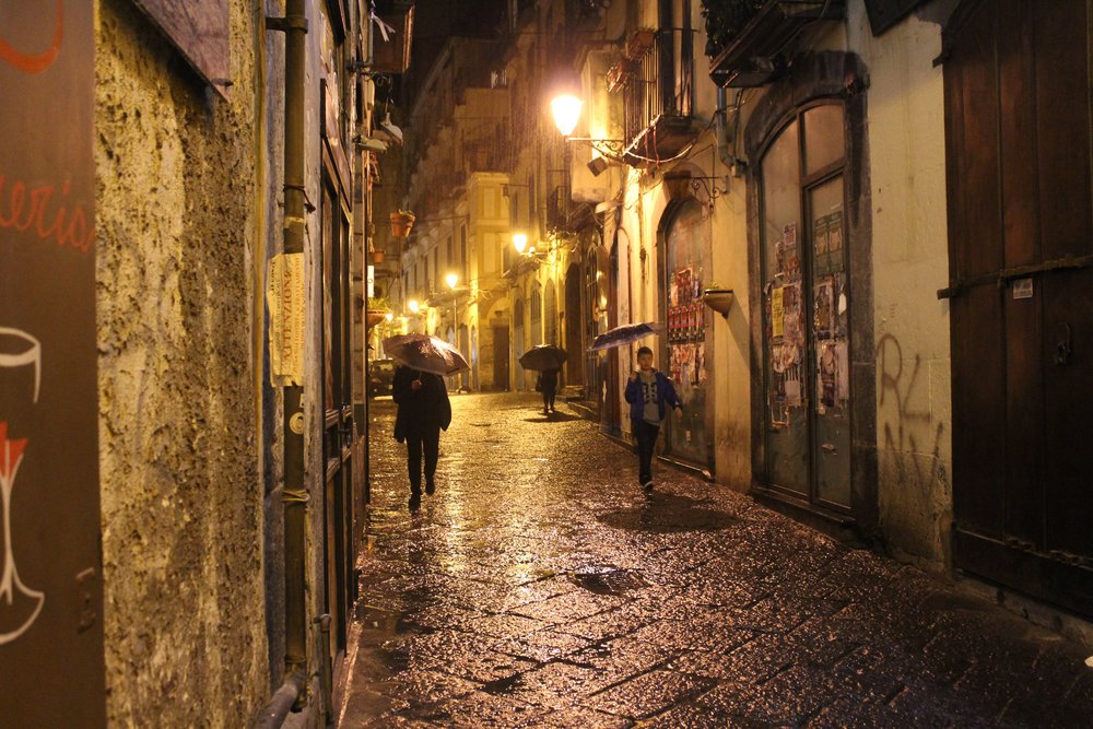 Salerno's historic center on a rainy night.