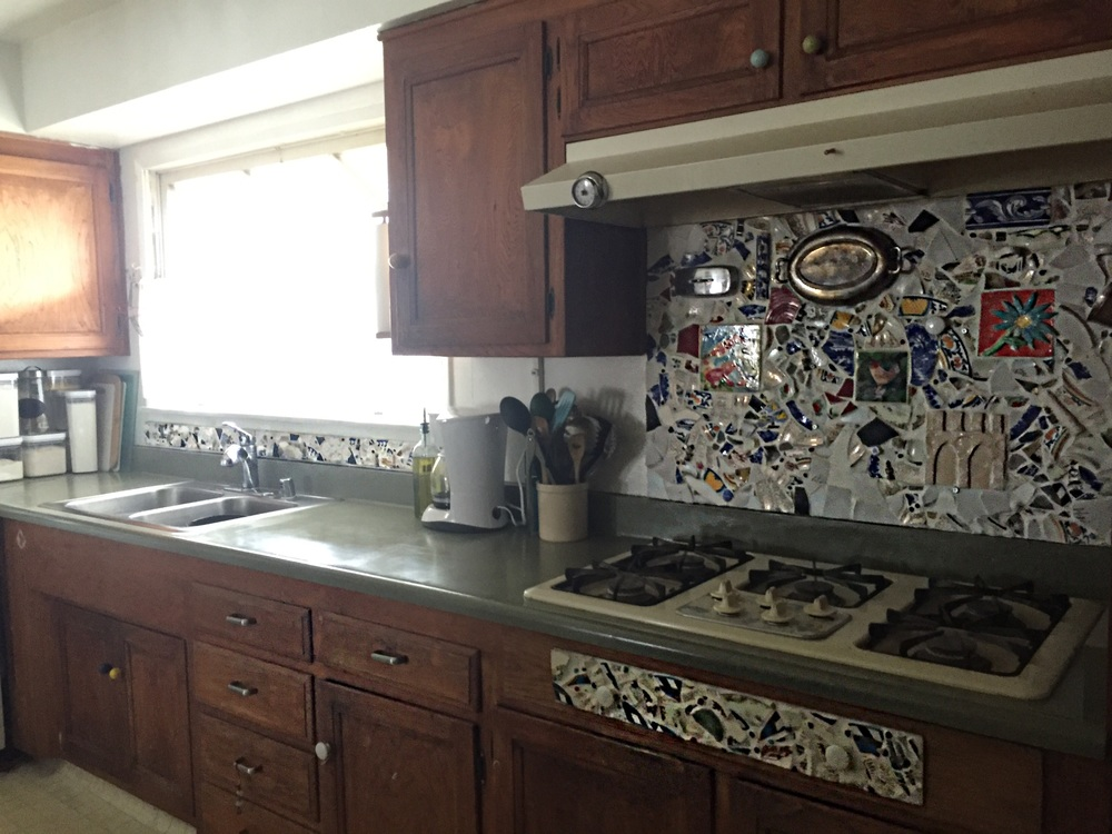 Anyone can make a backsplash from old ceramics or dishes see how here.