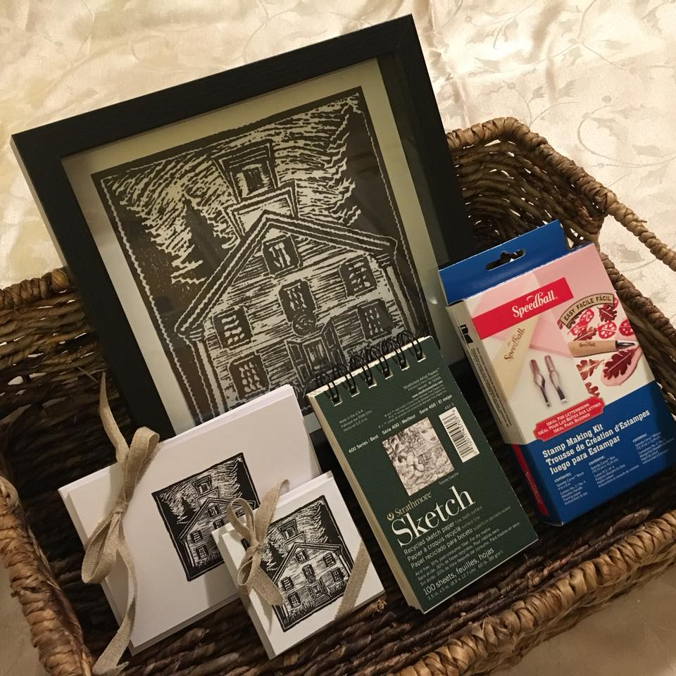 """This beautiful """"Treasure Hunt for Art"""" Package includes:  Framed Print of the Playhouse 2 sets of handprinted cards Speedball Stamp Making Kit Strathmore Sketchpad And a Guided 'Letterboxing' Hike in the NH Woods with artist / letterboxer Ann Putnam   Value: $245"""