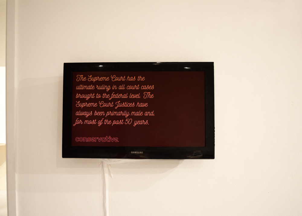 The video displayed in the installation is meant to be a supplementary source of information that doesn't necessarily go explain the Bill of Rights, but instead explains the context and the judicial system and how these laws came to be established.