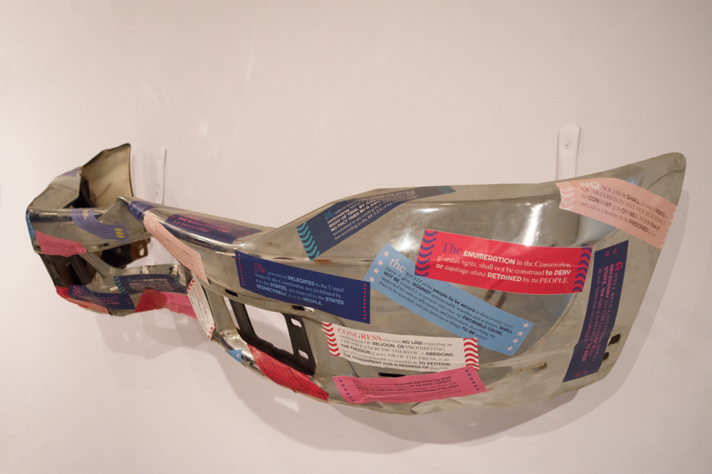 The installation contained stickers that were displayed on a pickup truck bumper and are impractical as actual bumper stickers, much like the language of the Bill of Rights and it's difficulty to be understood by much of the general population.