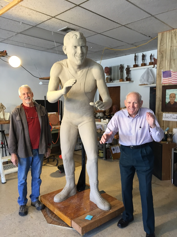 Jim Franklin (Sculptor) with Danny Hodge clay statue and Danny Hodge.