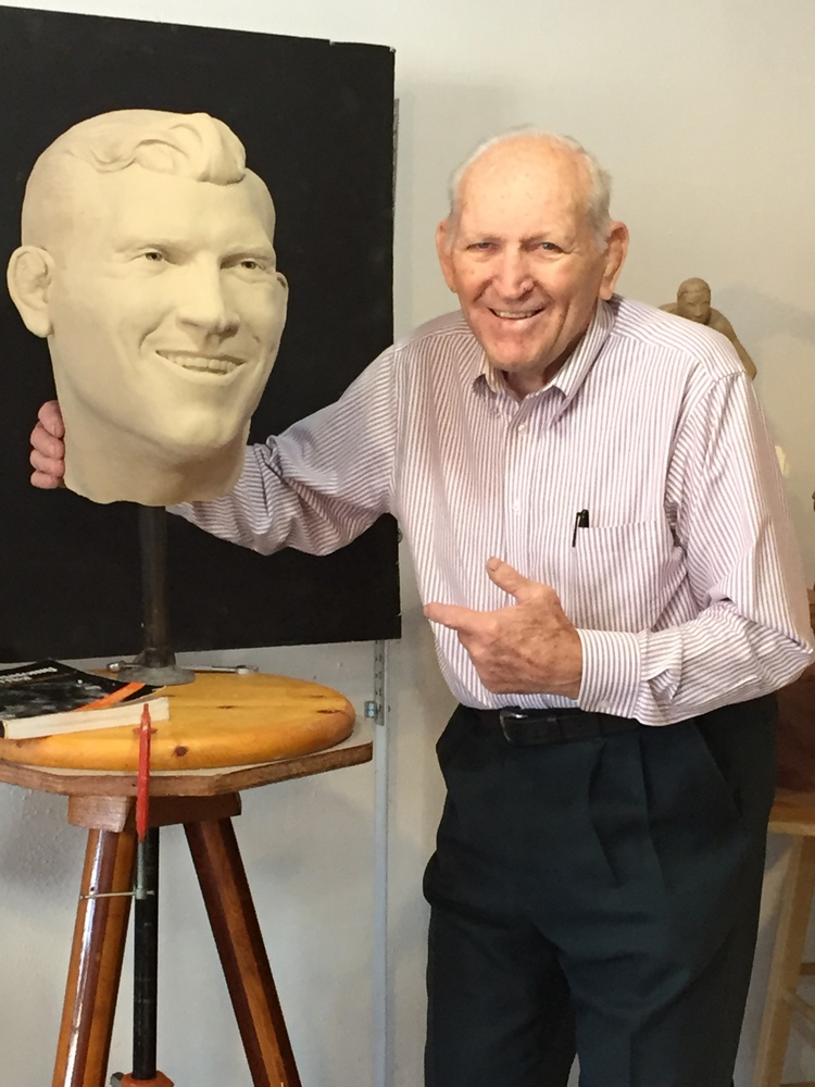 Danny Hodge with clay statue head.