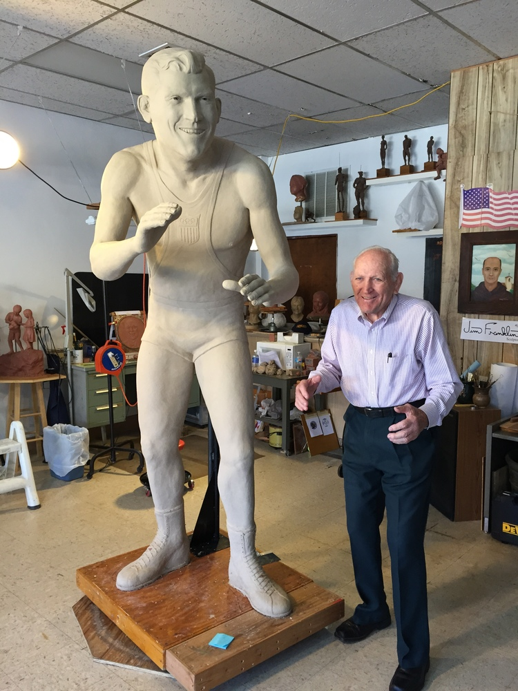 Danny Hodge with completed clay statue.