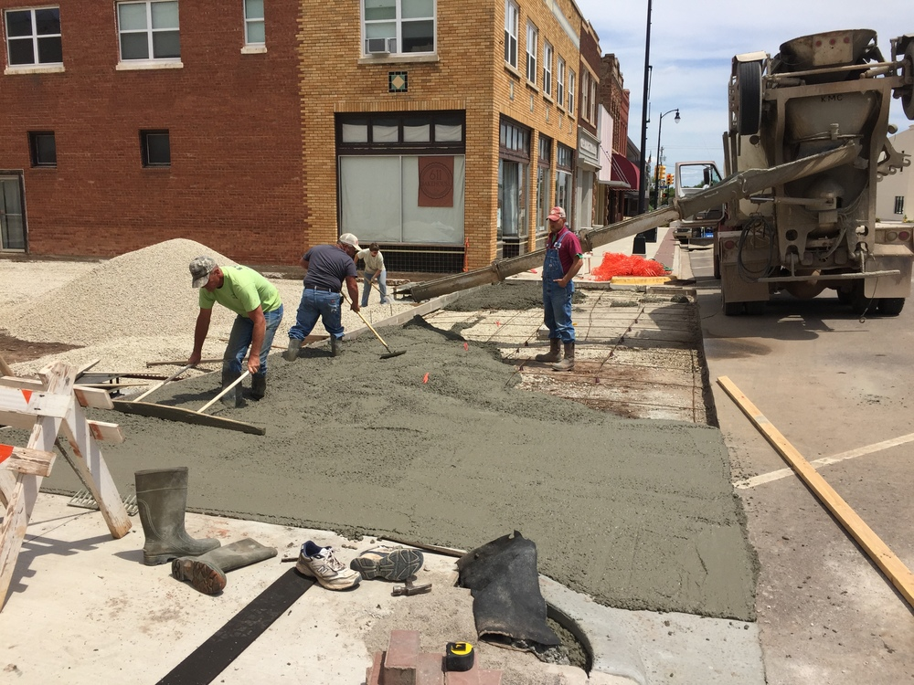 Pouring concrete for the sidewalk