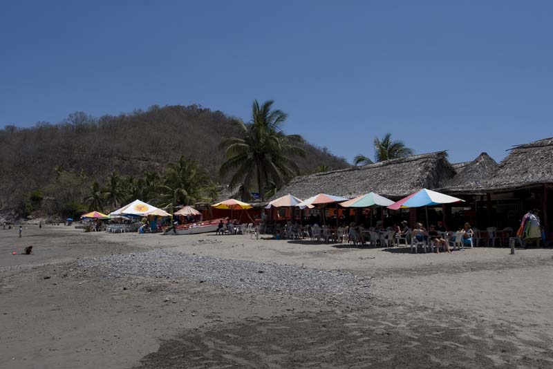Cuastecomate, parasols on beach