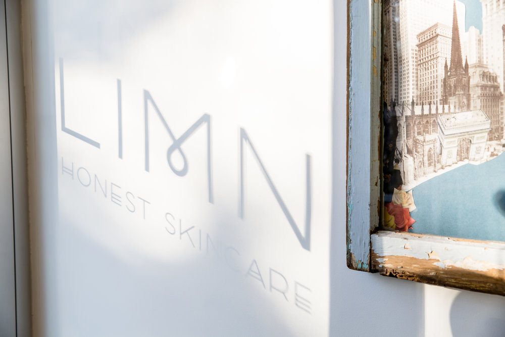 LIMN Skincare window reflection of name and tagline on wall image