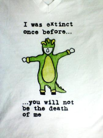 "Image of Dinosaur Onesie Project that Arianna silk screens for free. Text: ""I was extinct once before... (silhouette of Arianna in Dino Onesie) ...you will not be the death of me""."