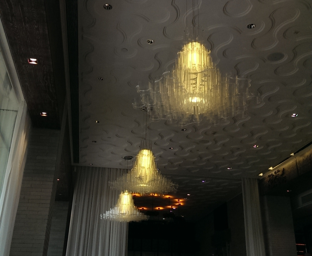 Cloud themed chandeliers at Ming Yang