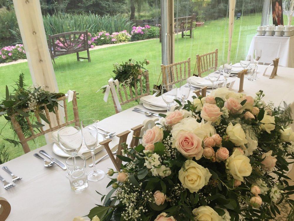 wedding marquee set table flowers lake.jpeg