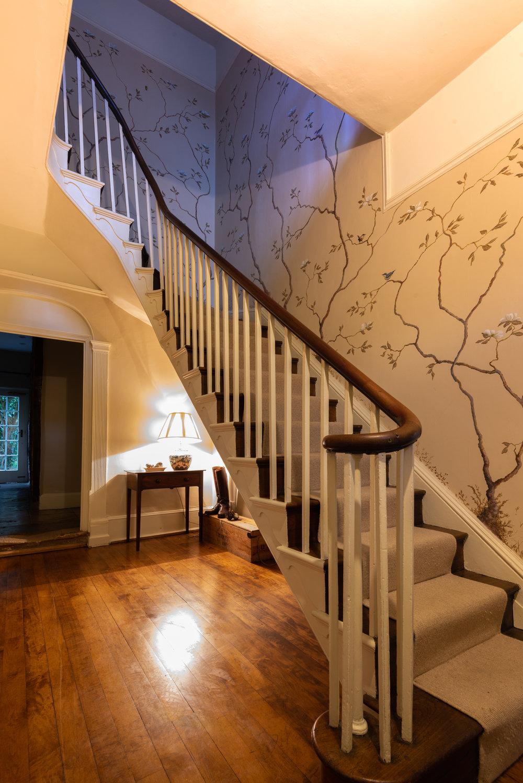 Hall stairs and handpainted wallpaper.jpg