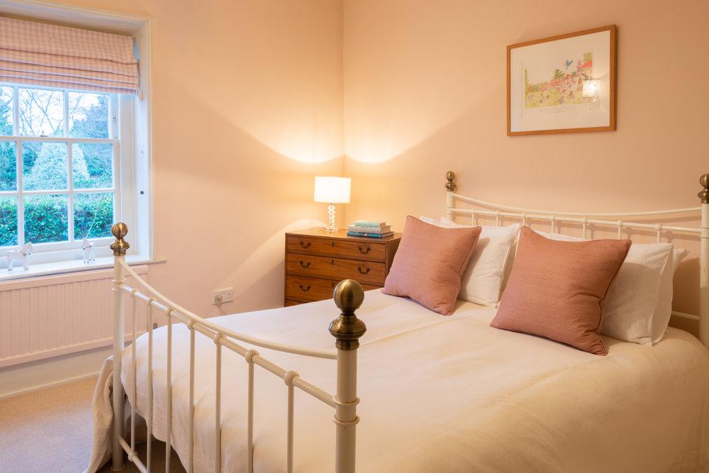 Pink brass bed.jpg