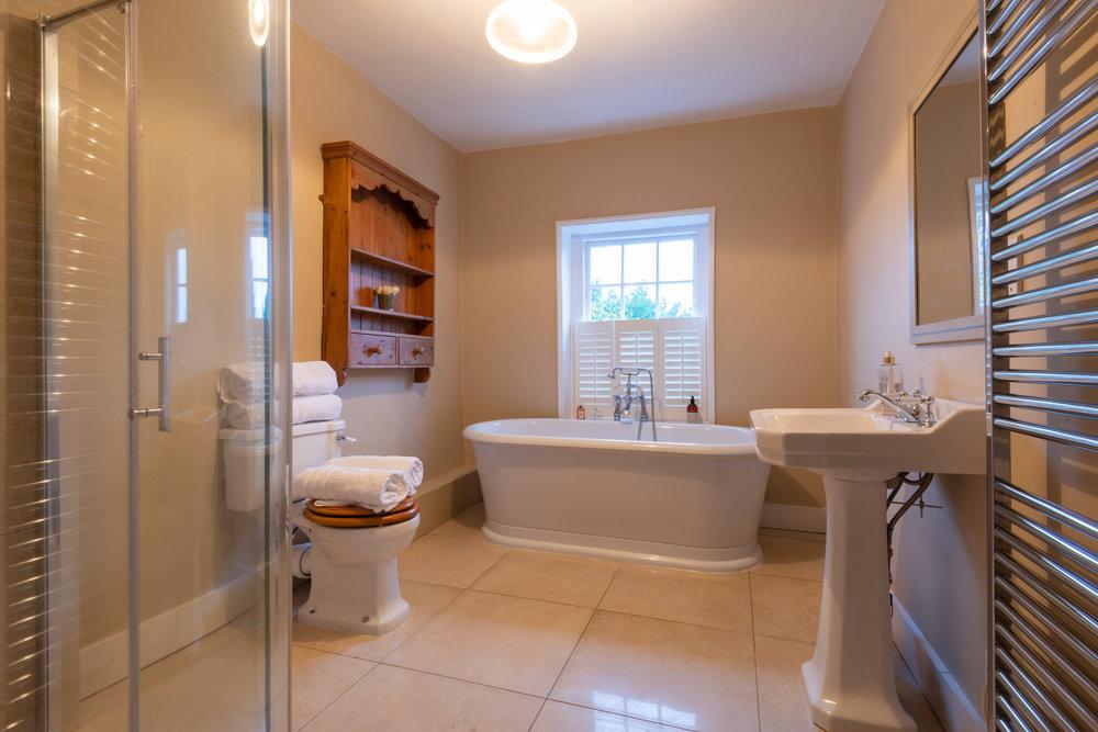 White bathroom and shower.jpg