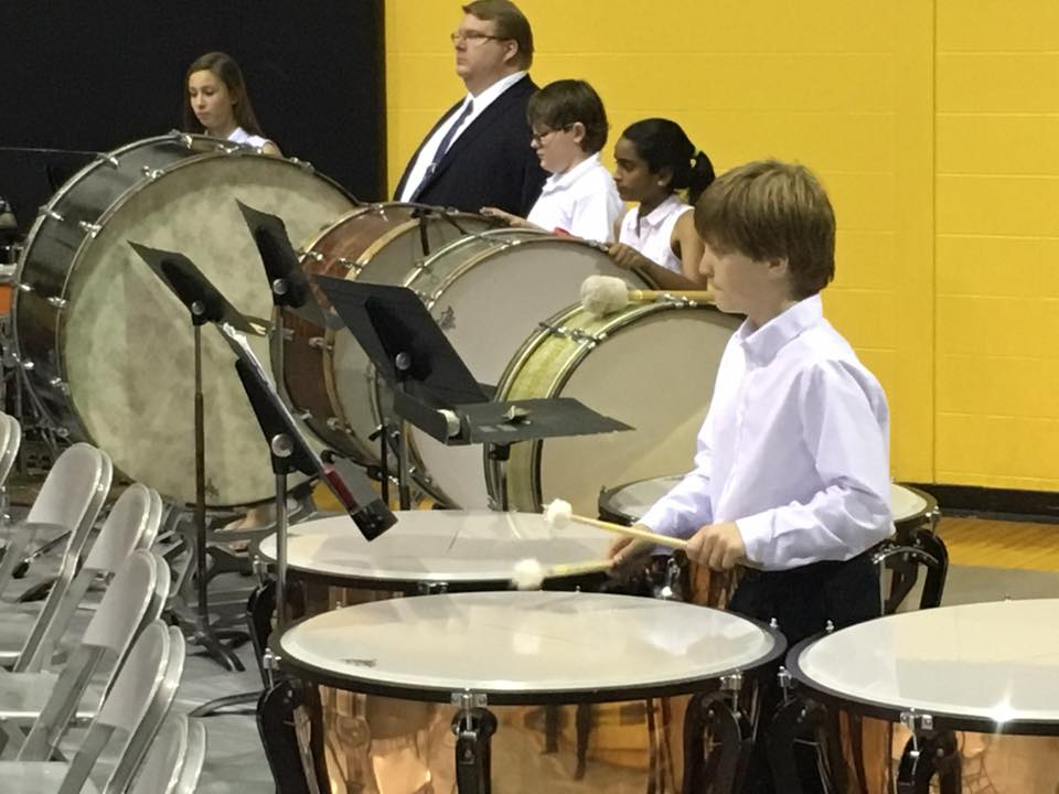 One of our 6th grade students participates in a combined band concert with other Lutheran school students at Lutheran South High School.