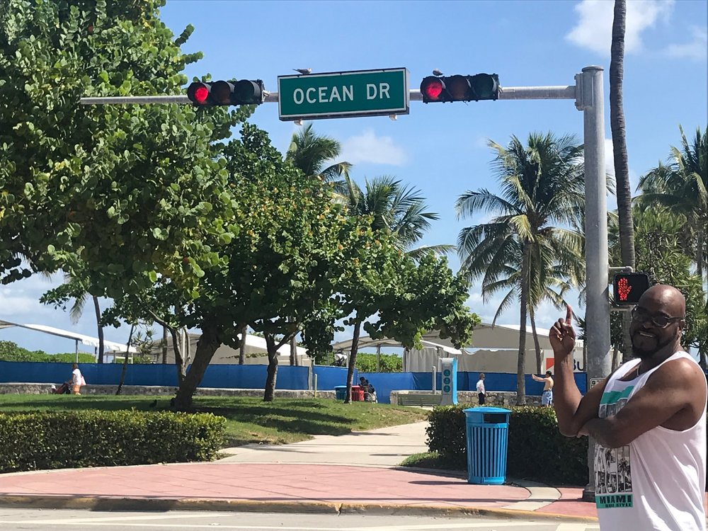 Pointing to Ocean Drive sign.JPG