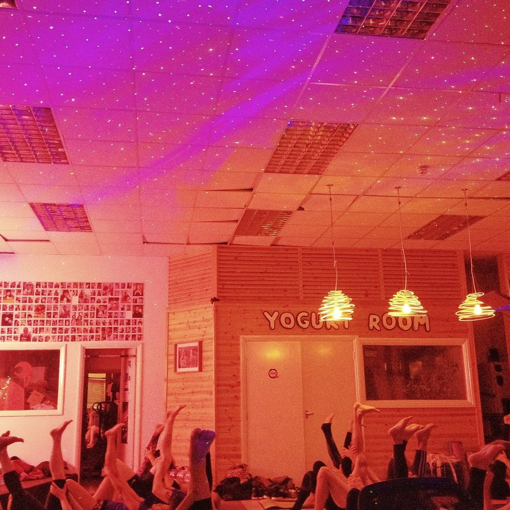 The Lick Yoga Project (UK)  - 2.5 year pay what you can community yoga in Brighton with lasers, music and free Fro Yo!