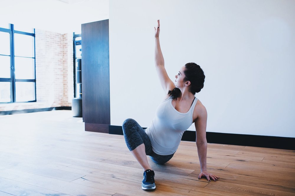 6 // Keeping your hips pushing toward the floor, raise the right arm up toward the ceiling, bringing your gaze toward the fingertips of the right hand. It's important to keep a tall, neutral spine here and to maintain space between the shoulders and the ears.