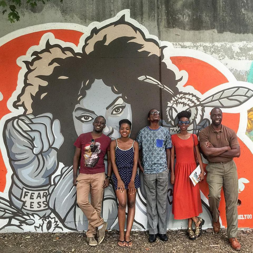 Jeremiah in a photo with 4 of the YALI African Washington Mandela Fellows after a tour of Atlanta's art scene.