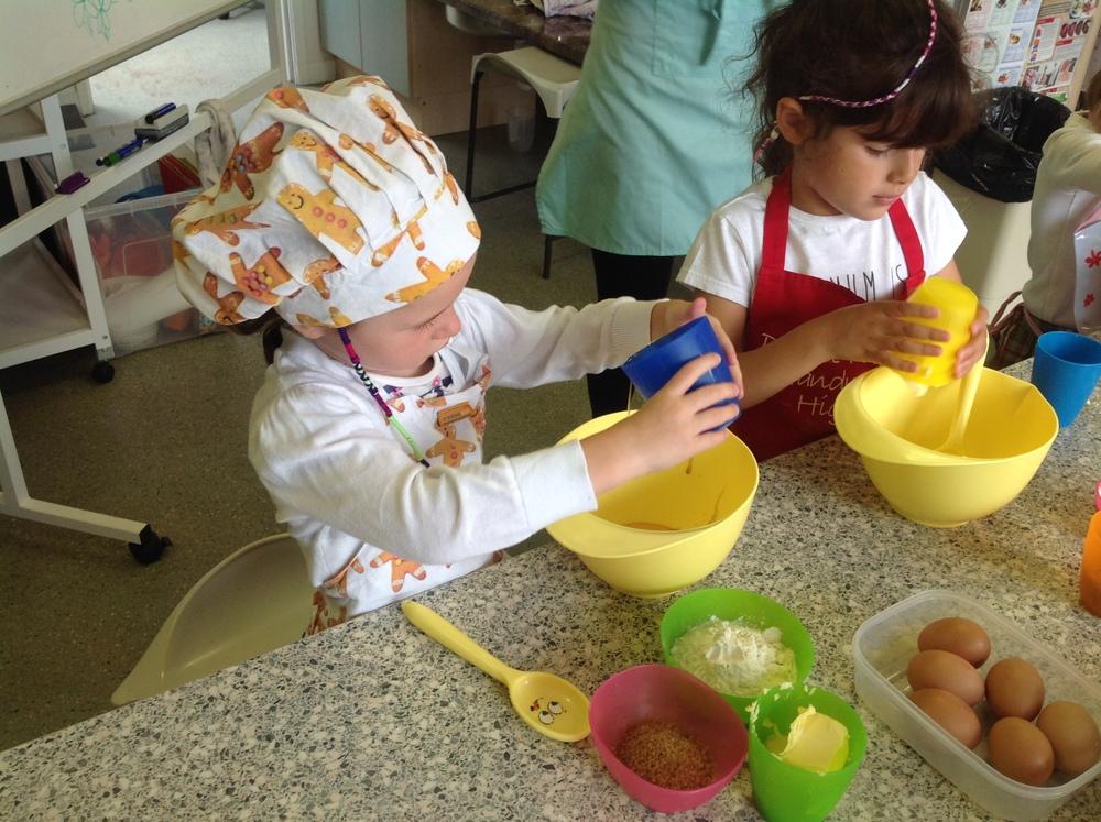 Adding ingredients for Miss Honey's Honey Cakes