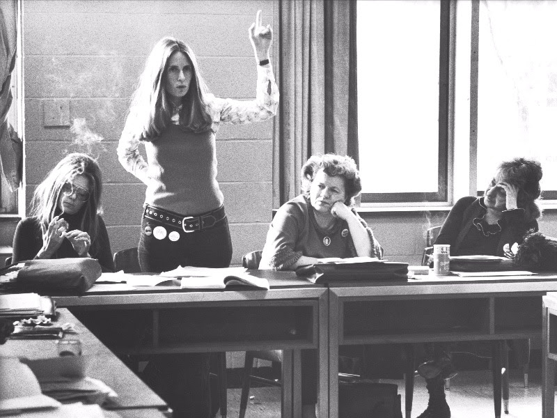 Brenda Feigen Fasteau arguing about candidate support while  Ms . editor Gloria Steinem, NOW President Wilma Scott Heide & feminist/author Betty Freidan look on, during meeting of the National Policy Council.