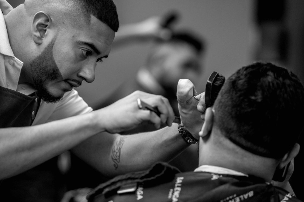 """""""It's 2019 and barbers aren't just men. My barbershop has a woman barber, Savannah, and her clientele is up there. Little girls will look up to her and should. We welcome all genders in my barbershop. It's about self-expression and I encourage everybody to express themselves to a certain extent, though I'm still the boss."""""""