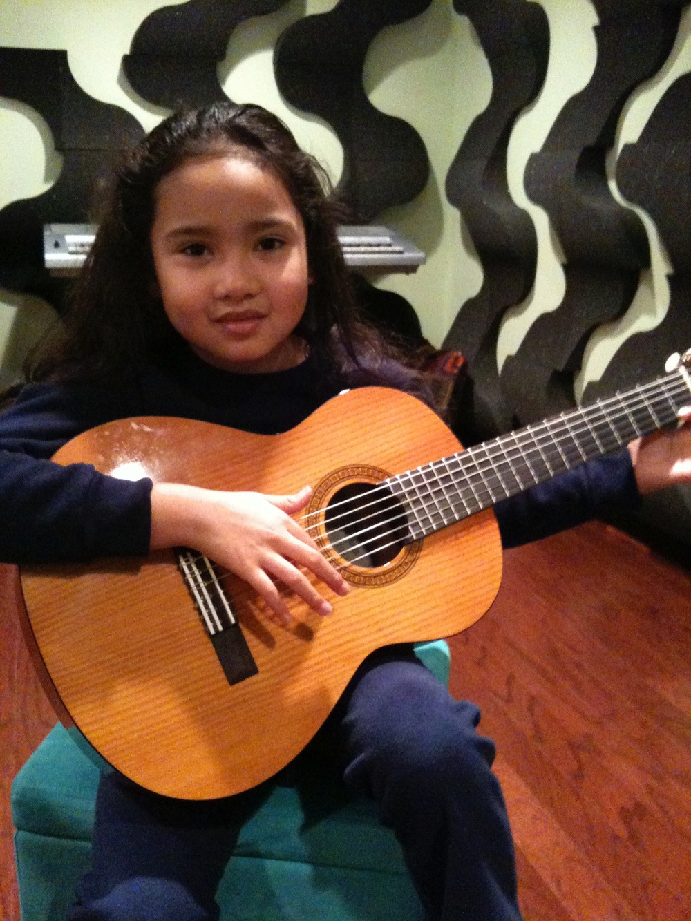 7 and a half years old playing guitar.jpg