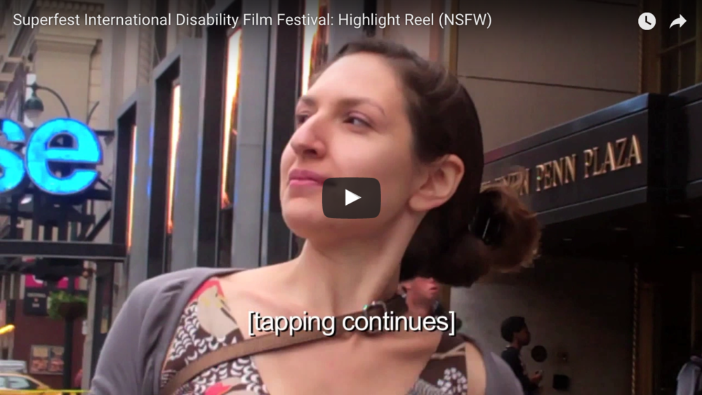 """A white woman using crutches walks down the street. Screen reads """"tapping continues"""" link NSFW"""