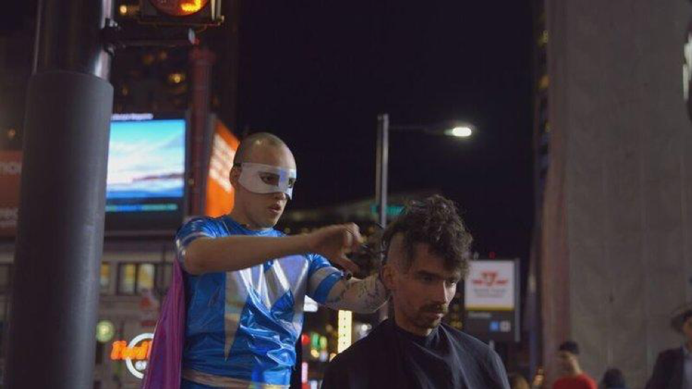 The Barber of Augusta - Toronto native Matthew Genser goes to great lengths to find his unexpected superpower: cutting hair. Like all superheroes, he has a dark side; but in his costume, he's invincible. Put on your cape and get lined up!