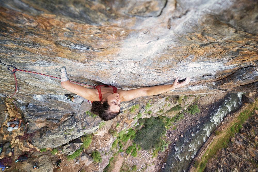 Maureen climbs a sheer rock-face, hundreds of feet in the air.