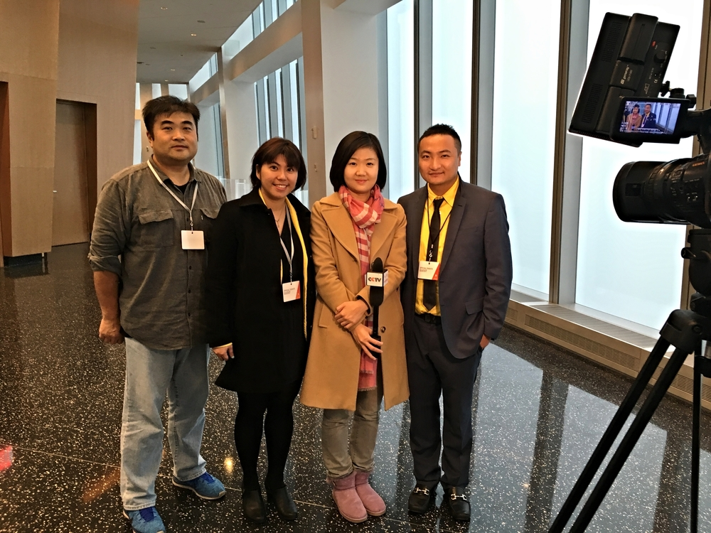CCTV staff (left one),Sasha Chou (left two) at UAP, CCTV Reporter (right two),Jason Song (right one) at L&L Travel.