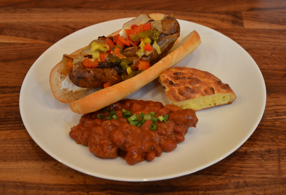 Spicy Seattle Dog with Cajun Andouille, Baked Beans with Bacon Sausage, and Cornbread