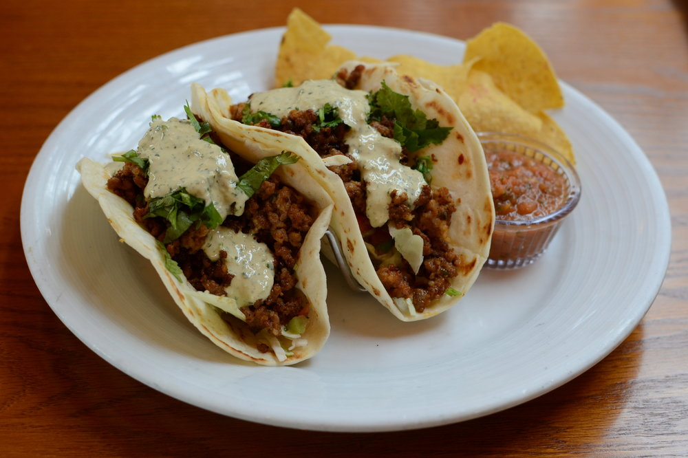 Chorizo Tacos with Cabbage, Pico de Gallo, Cilantro, and Chipotle Sour Cream