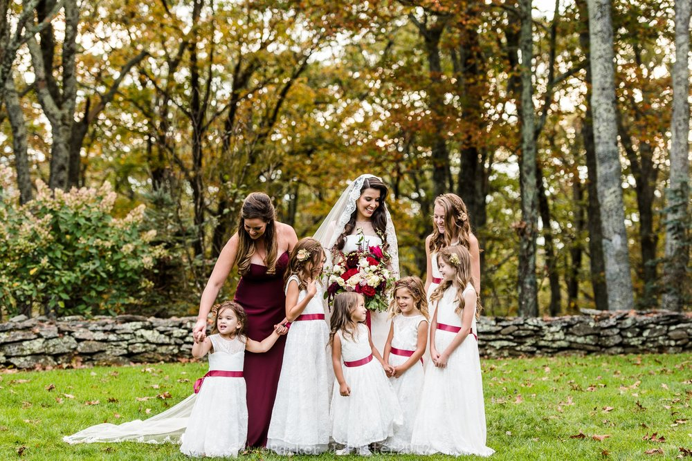 Bride with bridesmaids taking group pictures