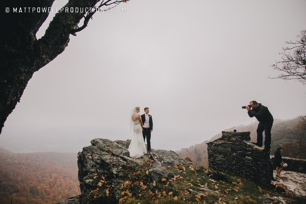 Matt Powell taking pictures of the bride and groom at the cliffs area