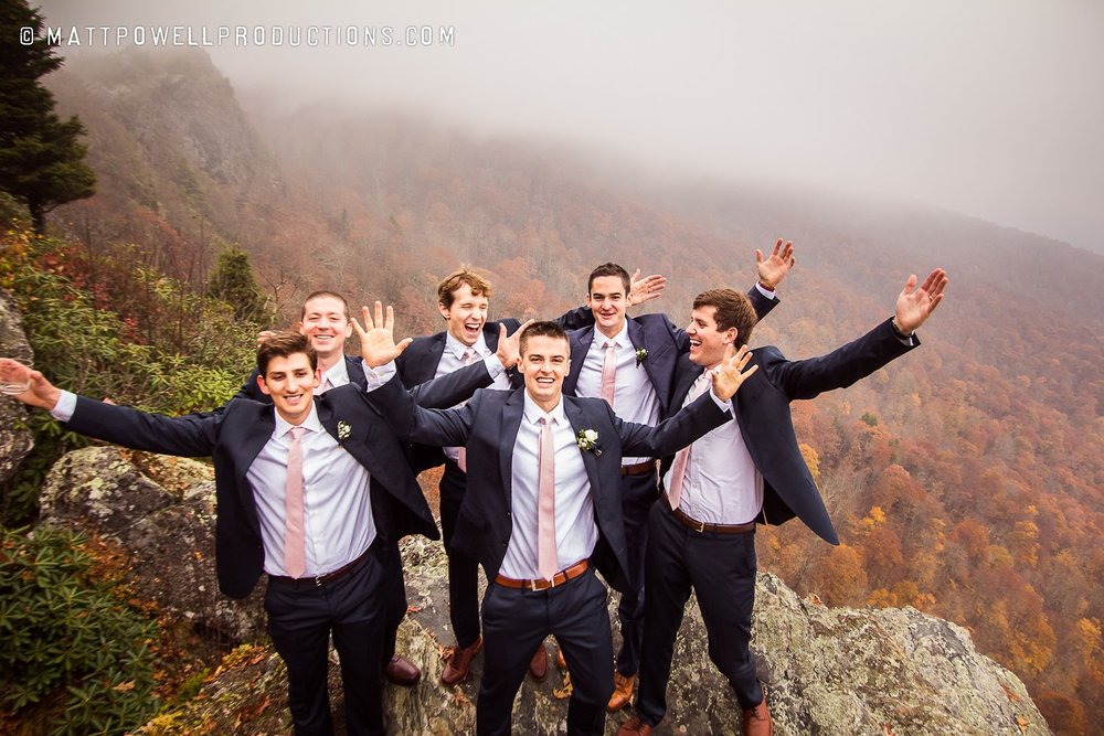 groomsmen celebrating with the blue ridge mountains in the background