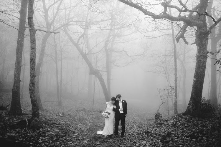 foggy wedding picture with the bride and groom