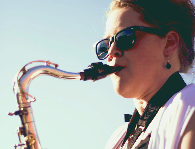 Meghan Poole - Saxophone /Honk HonkWhen you think of rock & roll bands you often think of a sax solo somewhere. Meghan has brought a whole new edge to the band with her technical abilities and irresistible grooves.Special AbilitiesCan get Jon to shut up when nobody can.