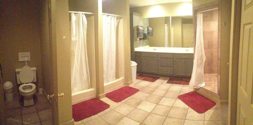Bathroom with 1 Commode, 2 Sink Vanity and 3 Showers