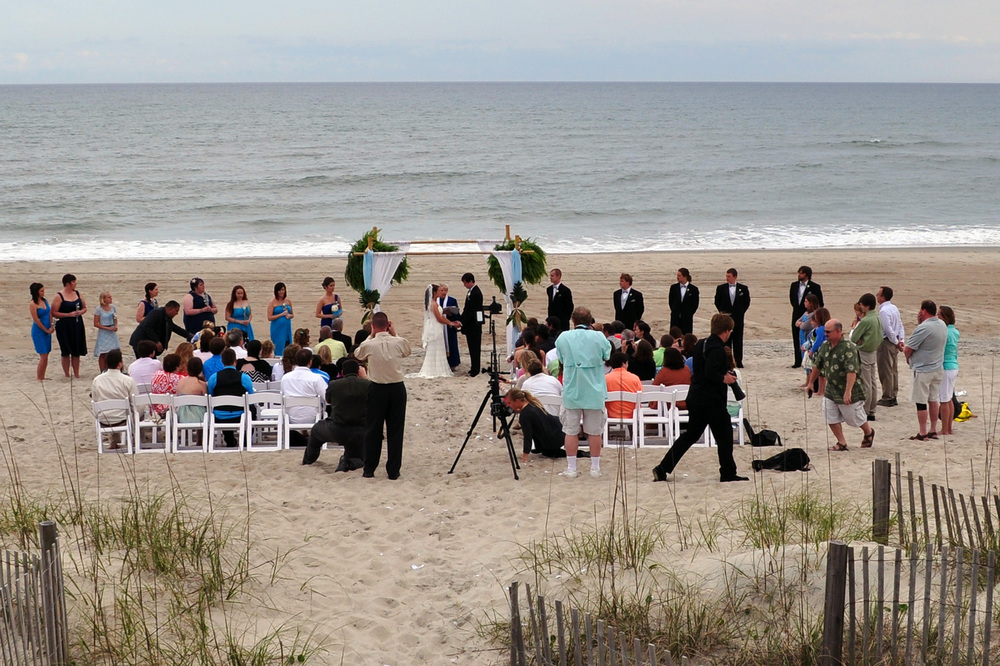 Reverend Beth officiates a beach wedding