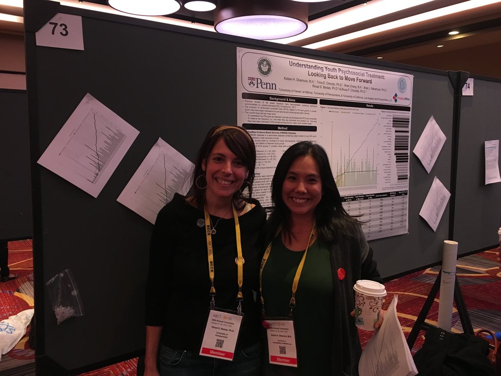 Kelsie Okamura, with Rinad Beidas, presenting a poster at ABCT on understanding youth psychosocial treatment