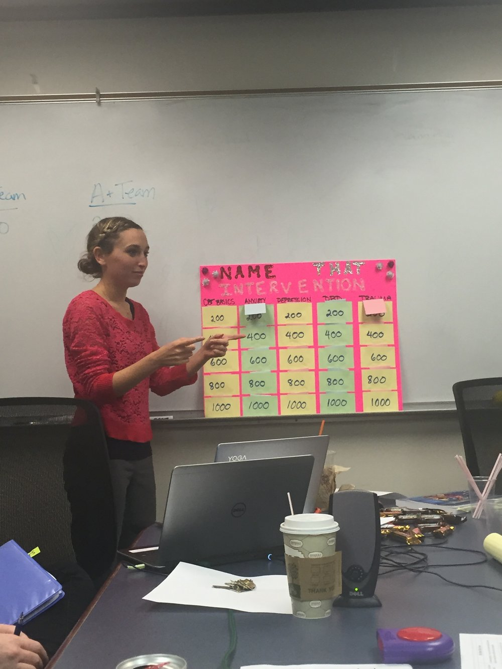 Emily Haimes hosting Jeopardy during a staff CBT training