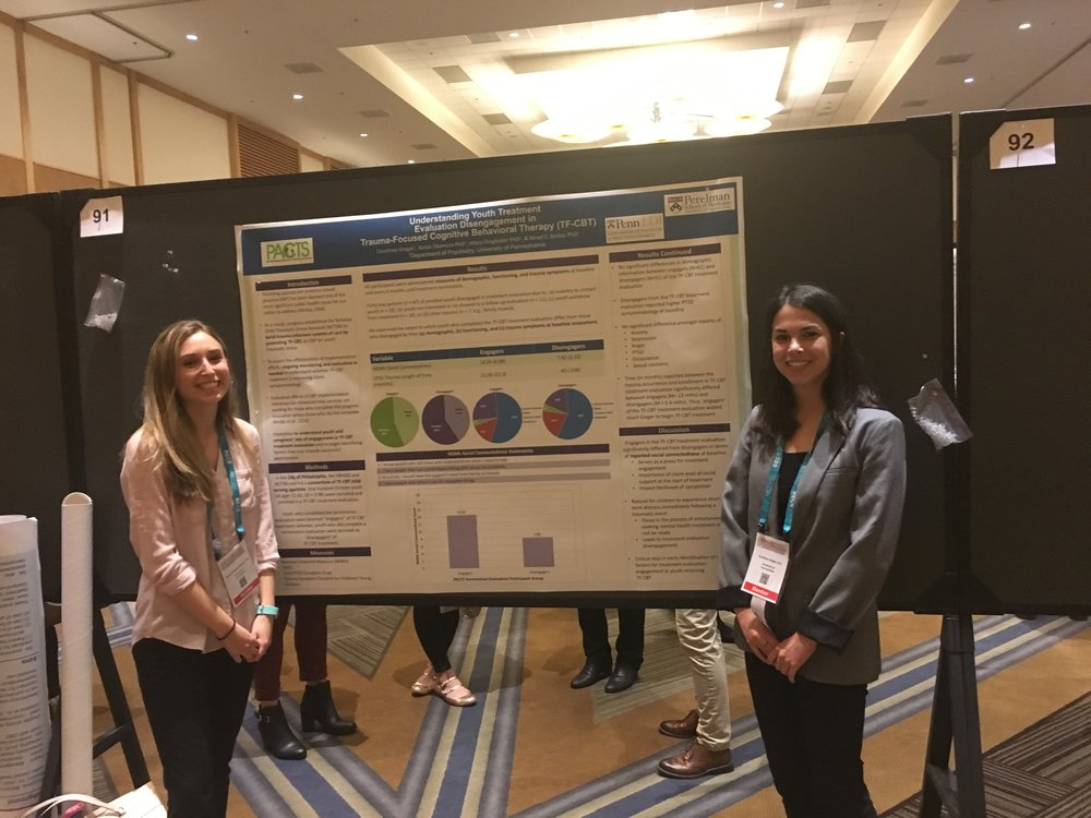 "Dr. Emily Becker-Haimes (postdoctoral fellow) and Courtney Gregor (clinical research coordinator) presenting ""Understanding Youth Treatment Evaluation Disengagement in Trauma-Focused Cognitive Behavioral Therapy"" at ABCT in San Diego (November 2017)"