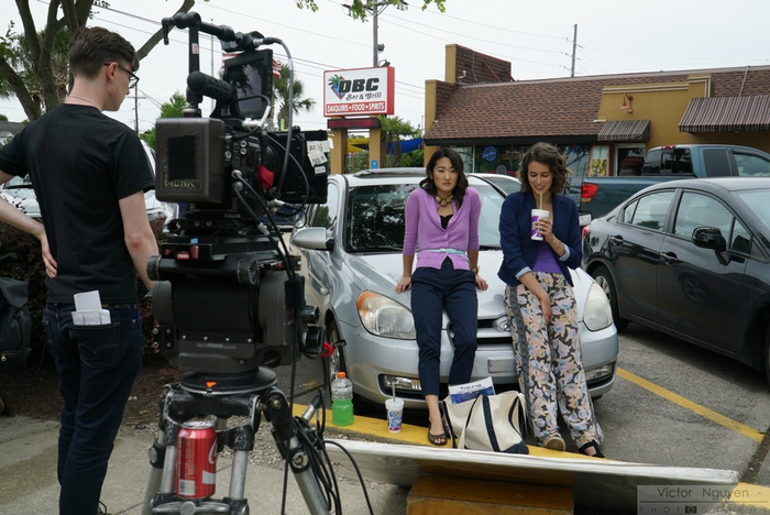 Alexa and Eunice at the daiquiri drive thru; 1st AD Alex Foreman policing the set