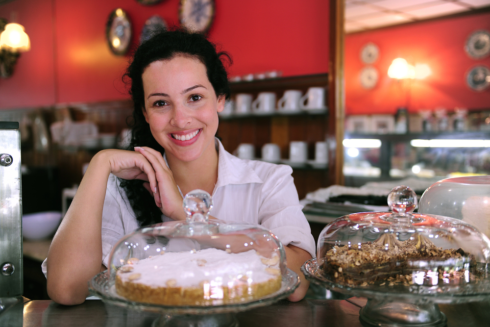 bigstock_owner_of_a_coffee_shop_showing_6899710.jpg