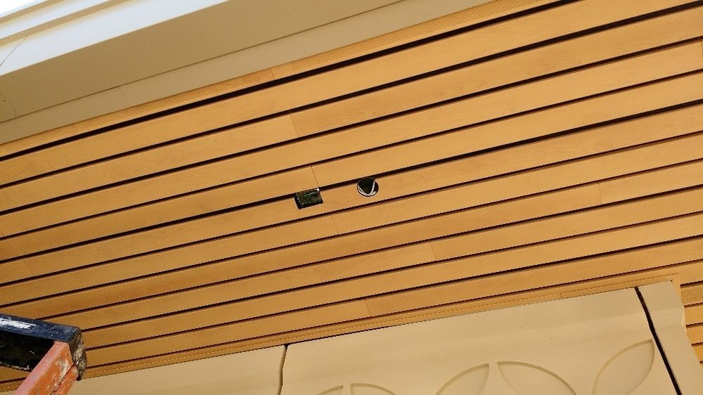 example of downlight + em light cutouts on nice exterior wooden soffit