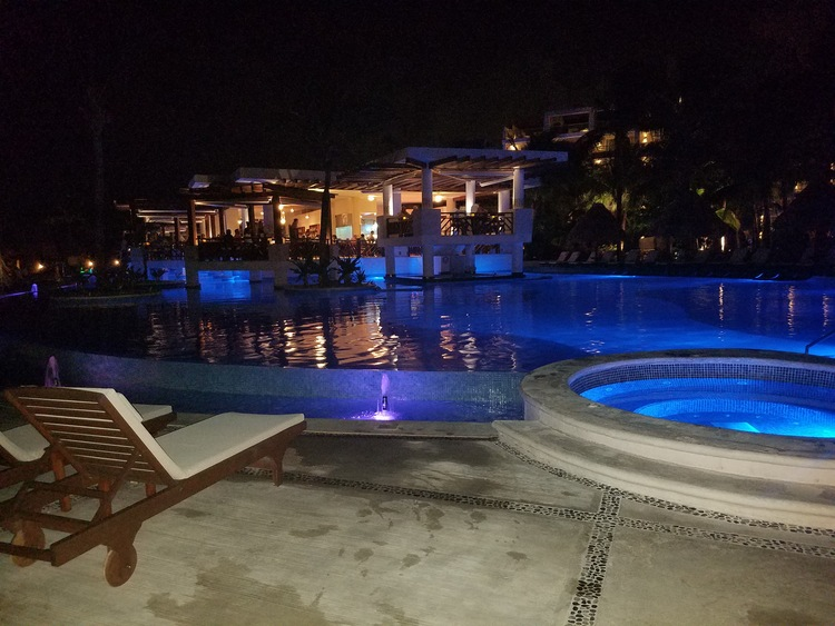 main-pool-night-view-excellence-playa-mujeres