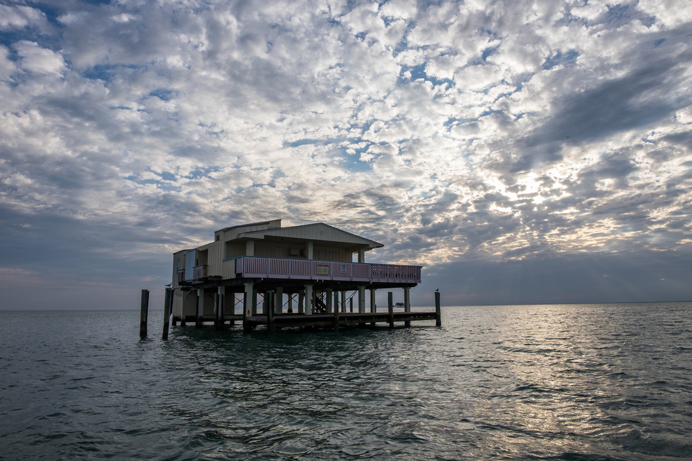 Historic Stiltsville in Biscayne National Park has an incredible story of pirating, bootlegging, survival at sea... classic old-time Miami!   Credit: Jonathan Irish