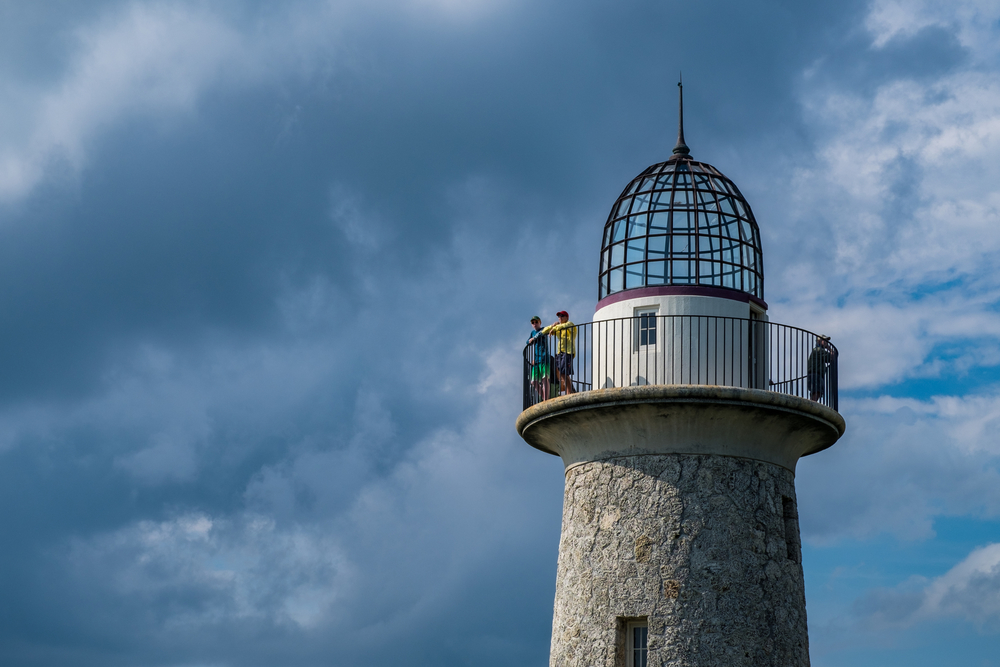 Later in the afternoon, a squall (storm) starts to roll in as visitors watch from the lighthouse.