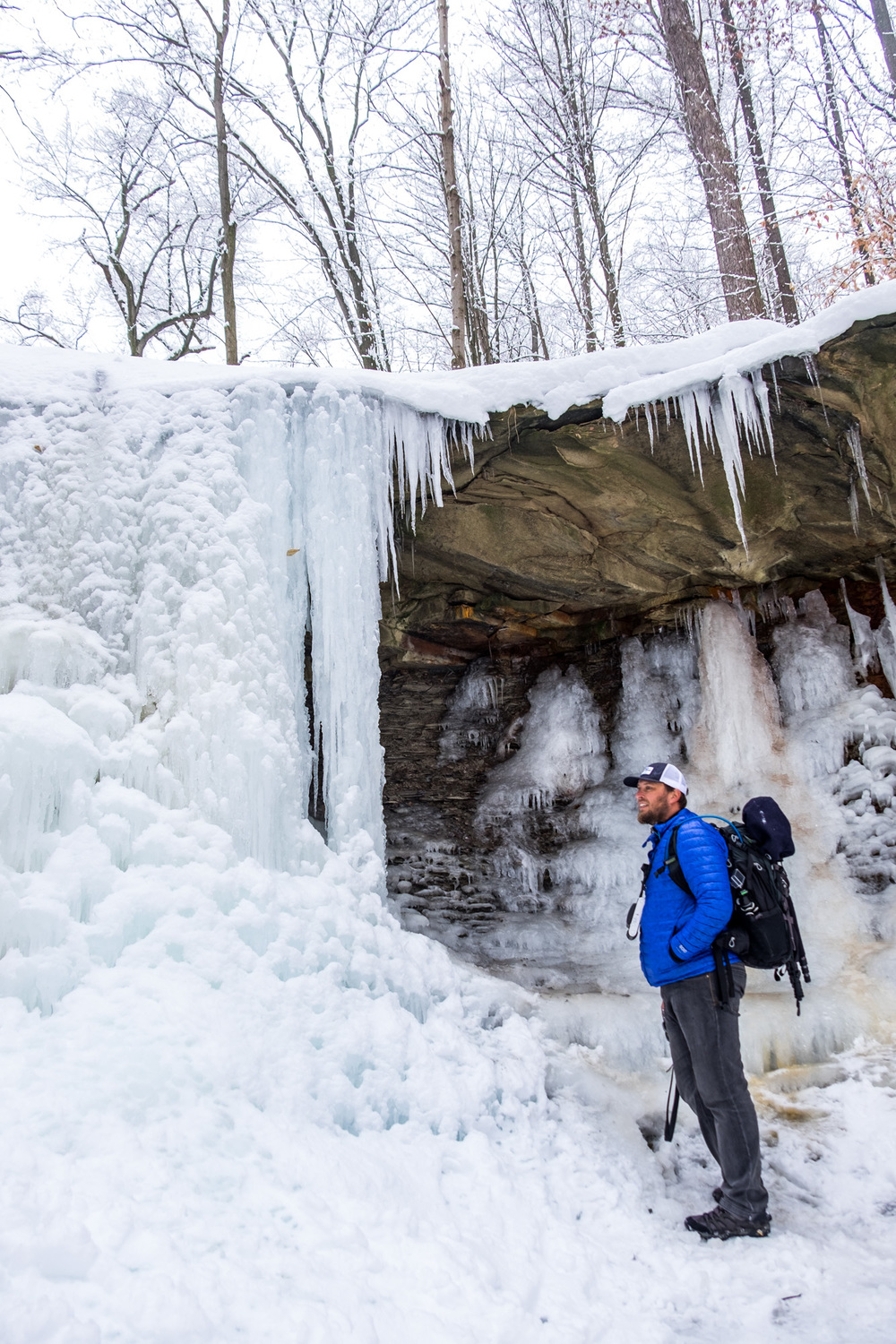 JI pondering if he should climb behind the frozen waterfall.