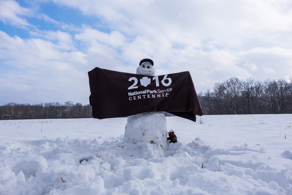 there was a field or fresh newfallen snow near the covered bridge. So we built a centennial snowman.